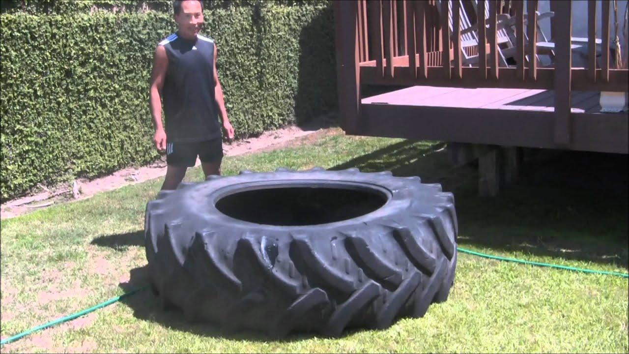 old skinny guy flipping 400lbs tractor tire - YouTube