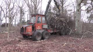 Volvo BM  forest machine transports the bushes from the meadow 2014