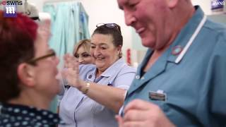 Hospital staff start their day with fun-filled ballroom dancing