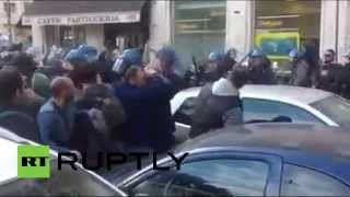 Violent clashes erupt between police and demonstrators over lay-offs in Italy Image