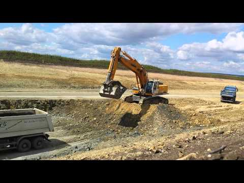 Liebherr R964C loading MB Actros dump trucks