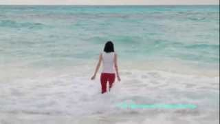 Vacation - swimming in Cancun in red pants and white top