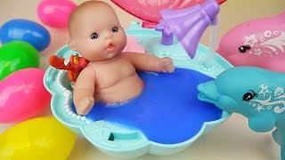 Baby doll Dolphin swim and Surprise eggs Slime Shellfish bath toys
