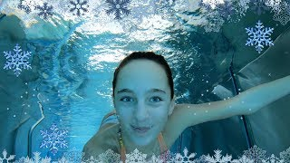 Carla Underwater swimming in a winter resort