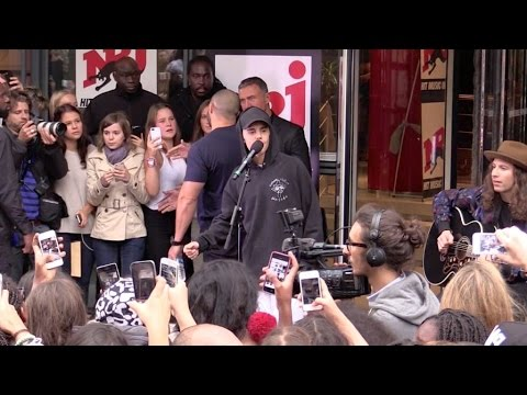 Justin Bieber performing If i was your boyfriend live outside NRJ radio station in Paris