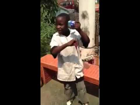 Amazing African Kid making beats with an open can and a pair of scissor