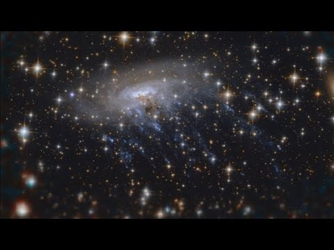Hubble captures incredible image of galaxy being ripped apart klip izle