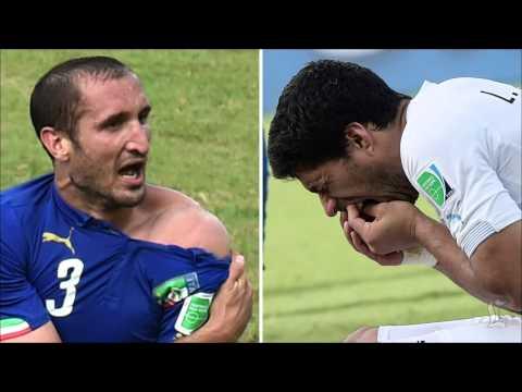 FIFA suspends Uruguay's Luis Suarez in World Cup biting incident