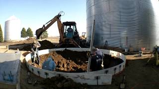 Digging a round hole for a grain dryer cement base (timelapse)