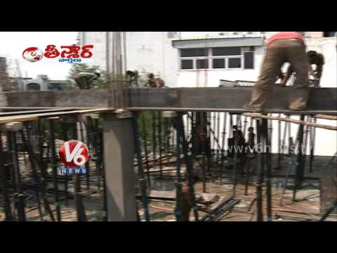 KCR one month in office - GHMC now attacks Gokul flats - V6...