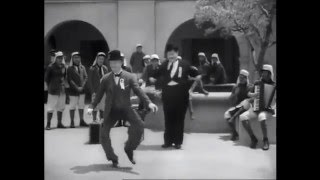 Laurel and Hardy dance to Boys Keep Swinging by David Bowie