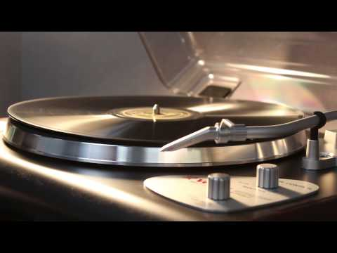 Warped shellac disc on turntable