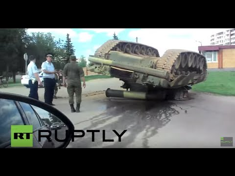 Russia: T-80U tank left overturned at side of road after accident