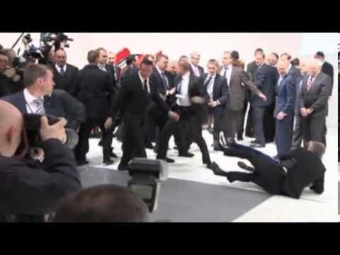 Topless protesters confront Vladimir Putin and Angela Merkel