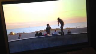 Aussie reporter Mike Amor hit in the head by flying skateboard while doing stand up in Venice, CA.
