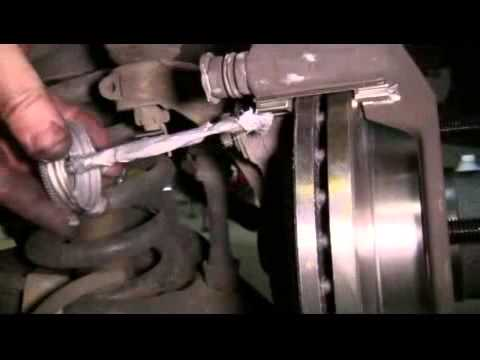 How to Replace the Front Brake Pads and Rotors on a 2003 Ford F150