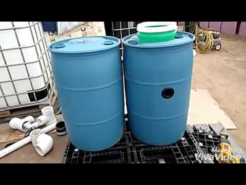 DIY swirl or radio flow filter using a 55 gallon plastic barrel and making the bottom convex.