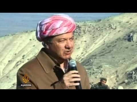 Kurds battle ISIL for control of Mount Sinjar