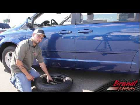 Changing the Tire on Dodge Grand Caravan. Chrysler Town and Country - Brandl Media Minute - 09-08-11