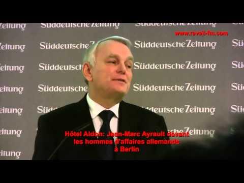 Réveil FM: Jean-Marc Ayrault  devant les Hommes et femmes d'affaires Allemands