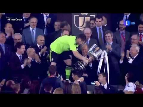 the king of spain  held the real madrid goalkeeper 'Iker casillas' leg in order not to fall.2014