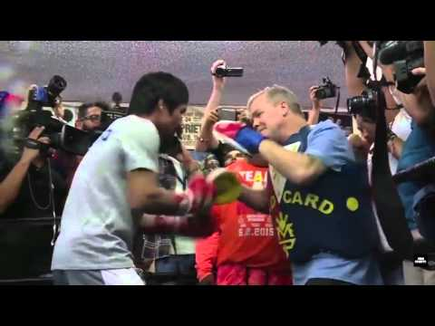 Manny Pacquiao works on the punch-mitts with Freddie Roach