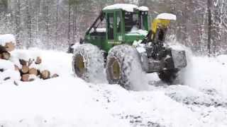 John Deere 540GIII Cable Skidder Packing Down Snow