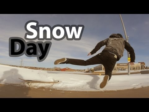 Snow Day - Skateboarding a Rail in the Snow