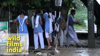 Village school girls wash off monsoon mud in Rajasthan