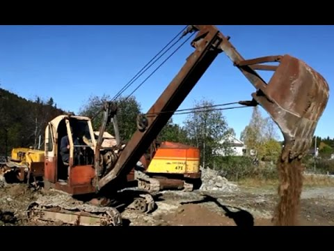 Dozer Cat D7 from 1944 and old excavators in action