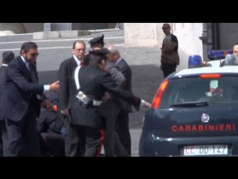 Police hurt in shooting outside Italian PM's office