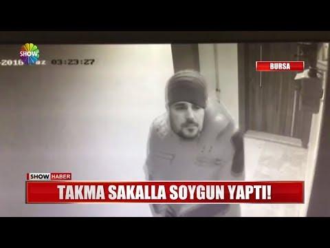 Takma sakalla soygun yaptı!