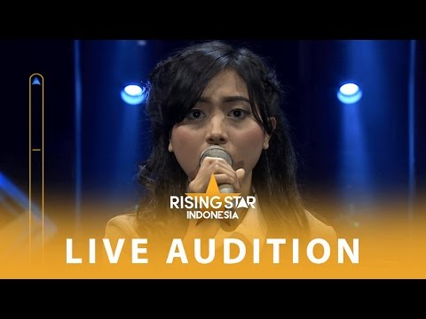 "Mega Indriyanti ""Writing's On The Wall"" 