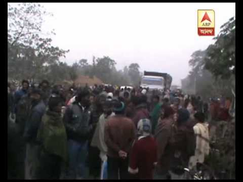 Tribal organisation's road blockade at North Dinajpur  to protest violence in Assam