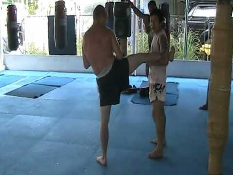 Roundhouse kick block and counter attack instruction by Wech @ Pinyo Muay Thai
