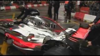 Jenson Button drives a Vodafone McLaren Mercedes F1 car through Manchester
