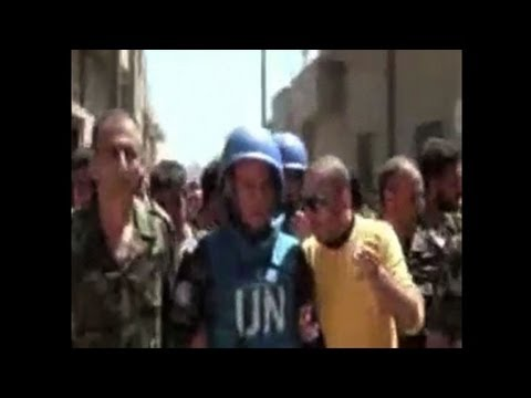 UN observers visit Syrian flashpoint city of Rastan