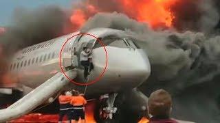 Co-Pilot climbs back into burning aircraft to save Captain