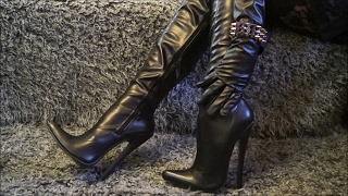 I'm in leather outfit and thigh high boots with 18 cm extreme heels