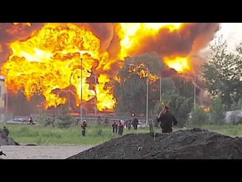 Blaze Engulfs Fuel Storage Site: Military base under threat as large oil storage tanks burn
