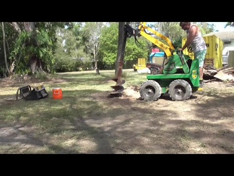 Review our work. Dingo Hire, Mini Digger Drills Post Hole 2m Deep with 450mm Auger.