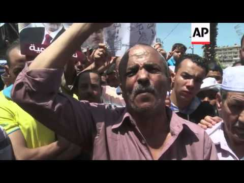 Morsi supporters remain defiant at sit-in near Cairo mosque