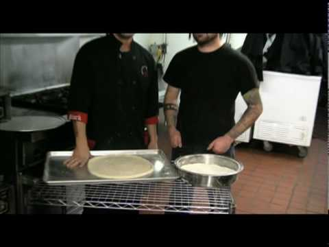 How to stretch pizza dough by hand with Tim from New Magnetic North.