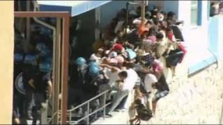Italian police beat migrants in Lampedusa clashes