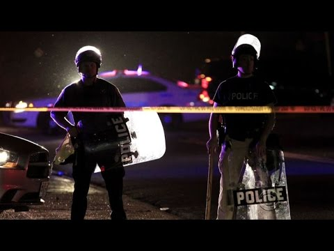 After night of violence, Missouri governor imposes curfew in Ferguson
