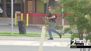 Investigators say veteran who took hostages at bank had machete in backpack