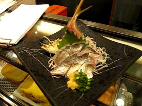 Live fish served in Japanese sushi restaurant