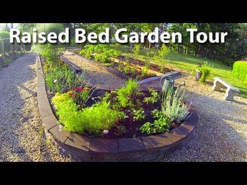 Raised bed garden tour concrete blocks and railroad tie for Concrete raised garden bed designs
