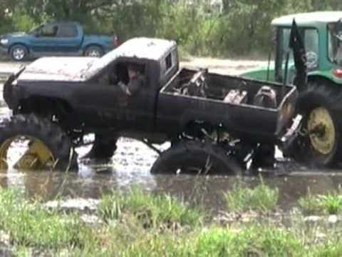 4x4 mud truck huge tires gettin stuck at Boggin Bunnell by MuddFreak Video