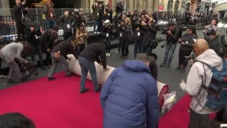 Workers roll out the Oscars red carpet